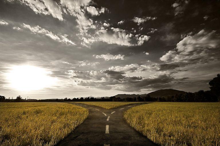 Crossroad,In,Rural,Landscape,Under,Dusk,Sky